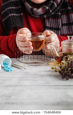 Close Up Photo Of Cup Of Tea, Pills. Sick Man's Treated