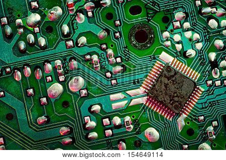 Close up of a printed green computer circuit board. electronics and IT manufacturing and business background