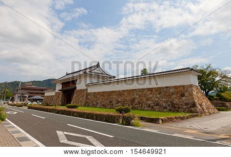 MAIZURU JAPAN - JULY 29 2016: Reconstructed in 1997 Main Gate and walls of Tanabe castle. Castle was erected in 1579 by Hosokawa Fujitaka abandoned in 19th c. partly reconstructed in 1940 and 1997