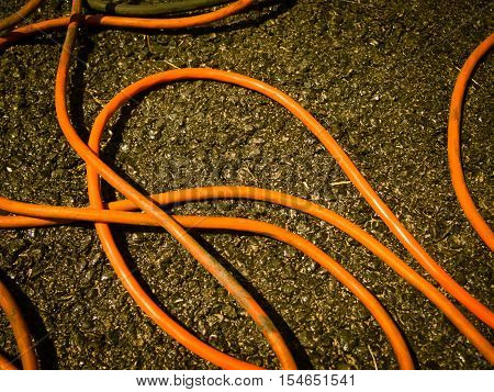 The Orange Extension Cord On The Ground At The Construction Site