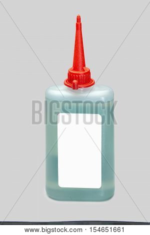 Plastic bottle of lubricating machine oil on a grey background
