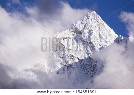 Kangtega mountain with clouds. During the way to Pheriche Village (4240 m). Route of Lukla-Everest base camp. East Nepal, Himalayas