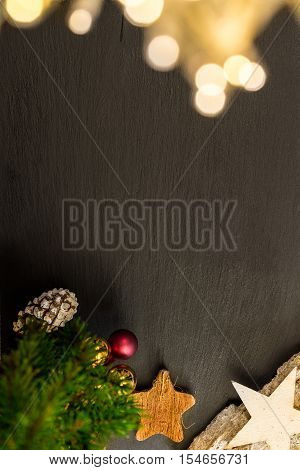 Christmas Decoration With Lights On Shale As Background