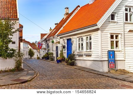 Street with white houses in the old part of Stavanger Norway.