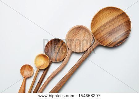 different kitchen wooden utensils on a white background