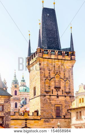 View on the Lesser town with bridge tower and saint Nicholas church in Prague city