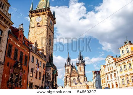 Cityscape view on the clock tower and Tyn cathedral in the old town of Prague