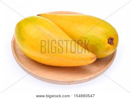 Egg fruit Canistel Yellow Sapote (Pouteria campechiana (Kunth) Baehni) in wood dish isolated on white