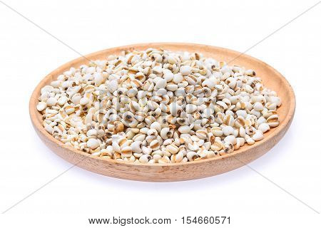 Millet rice millet grains in wooden dish isolated on white