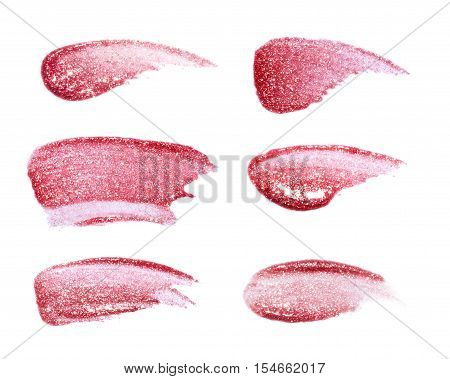 Different lip glosses isolated on white. Smudged lip gloss sample