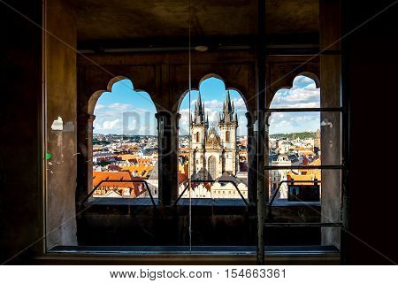 Cityscape view on the Tyn cathedral from the clock tower in the old town of Prague
