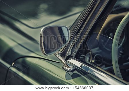 Close Up On Rear View Mirror On Greenv Intage Car.