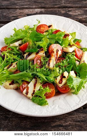 Grilled Halloumi Cheese salad witch tomatoes and lettuce. healthy food.