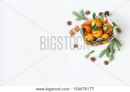 Christmas composition with tangerines fir branches cinnamon sticks anise star. Christmas background. Flat lay top view
