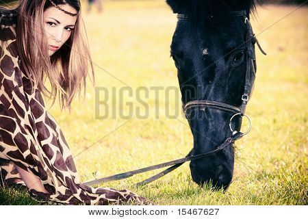 woman and horse portrait on a meadow
