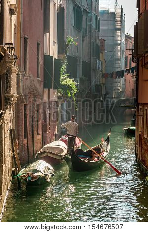 Lone gondolier in Venice Floating in hot summer