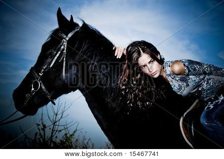 beautiful young brunette woman  ride black horse poster