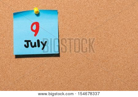 July 9th. Day 9 of month, color sticker calendar on notice board. Summer time. Empty space for text.