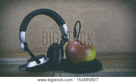 Headphones On A Wooden Background, Dj Headphones, Earphones, Headphones And Music And Apple