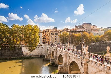 Rome, Italy, October 15, 2016: Sant'Angelo Bridge across the Tiber river, aerial view from the Castle Sant'Angelo, Mausoleum of Hadrian, Rome, Italy