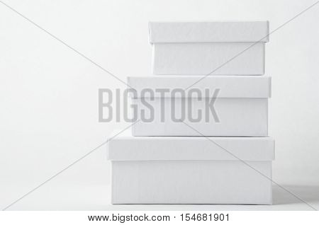 Stack Of Three Plain White Boxes With Lids