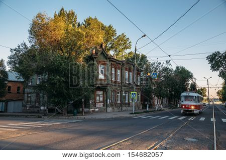 Samara, RUSSIA - August 14, 2016: Old street, old wooden house with plats, old tram number three, old Samara, Russia
