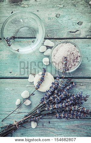 Spa and wellness setting with lavender flowers floral water and bath salt. Dayspa nature set