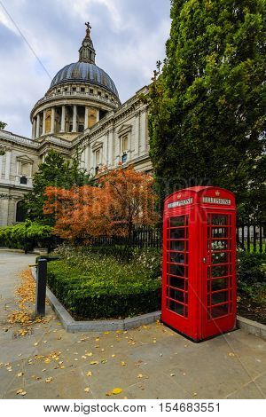 Streets of London, Red Telephone Box in autumn scenery in London, England