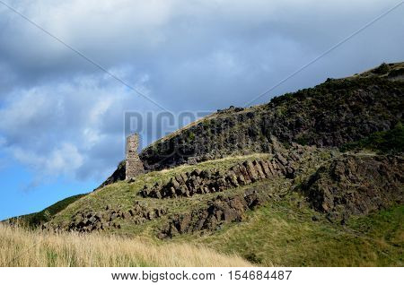Stone ruins of Anthony's chapel from the base of Arthur's Seat.