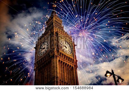 explosive fireworks display around Big Ben. New Year's Eve in the city - celebration background