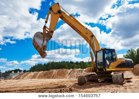 Loader excavator at sandpit during earthmoving works