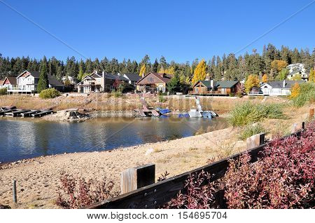 Mountain homes sit around Boulder Bay at Big Bear Lake in Southern California.