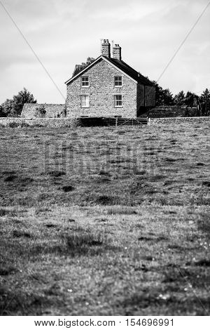 English farm cottage in dramatic high contrast black and white