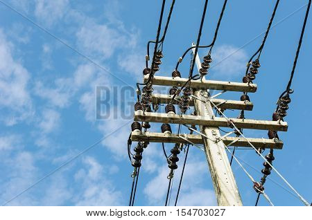 Electricity power pole and blue sky backgound