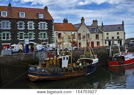 Boats and houses in Eyemouth old fishing town in Scotland UK. 07.08.2015