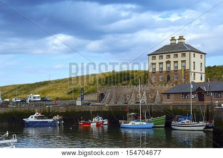 The House of Secrets. Boats and houses in Eyemouth old fishing town in Scotland UK. 07.08.2015