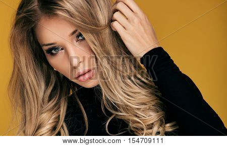 Beautiful Blonde Woman With Long Curly Hair.