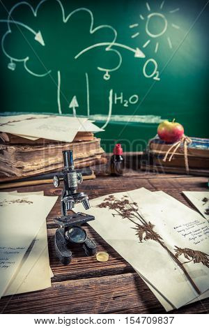 Vintage lesson biology and photosynthesis on old wooden table