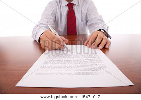 businessman offering the pen for signing a contract (selective focus)