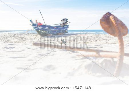 fishing boat on the beach blue sky.