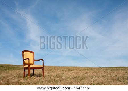 empty chair outside at the grass field