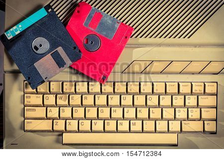 Closeup of vintage floppy disks and keyboard