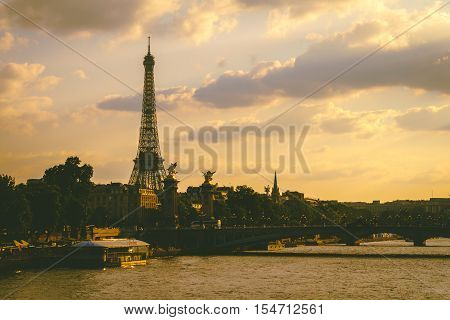 Eiffel tower beside river Seine in the evening