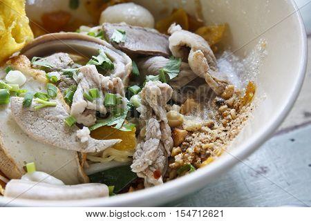 closeup dried noodle soup pork noodle soup gourd nai eak nai eak tomyum noodle thai noodle on wood table and country style