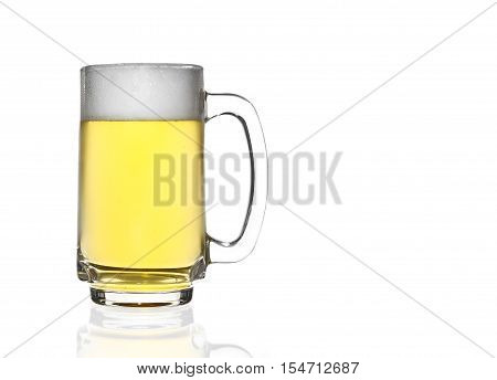 front view frosty lager light beer and white bubbles in clear glass with handle and steam for winter drink or celebration isolated on white background and reflection for beer glass with space