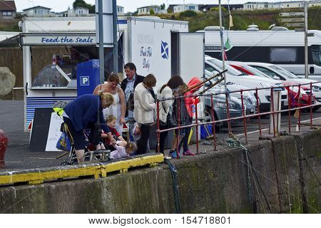 Tourists in Eyemouth old fishing town in Scotland UK. 07.08.2015