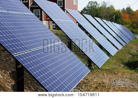 solar panels installed in a row at solar station
