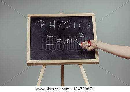 Physics Word And Formula E=mc2 On Chalkboard