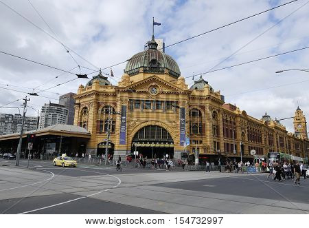 MELBOURNE, AUSTRALIA - JANUARY 24, 2016: Iconic Flinders Street Railway Station in Melbourne. It was completed in 1910 and is used by over 100,000 people each day