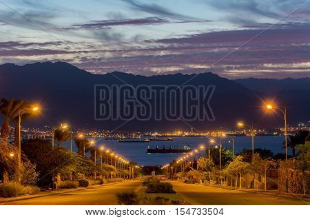 Scenic view on the Red Sea, marine port of Aqaba and Jordanian mountains; photo was taken from the longest street in Eilat, Israel